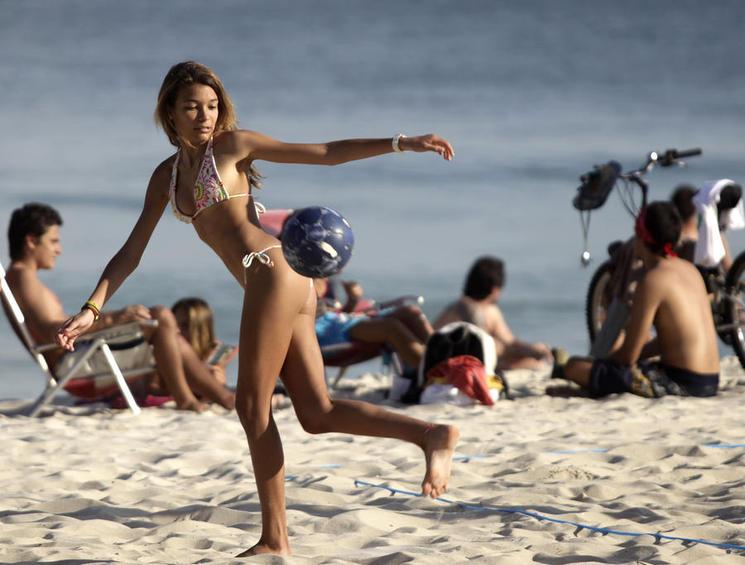 A girl controls a soccer ball in Ipanema beach in Rio de Janeiro