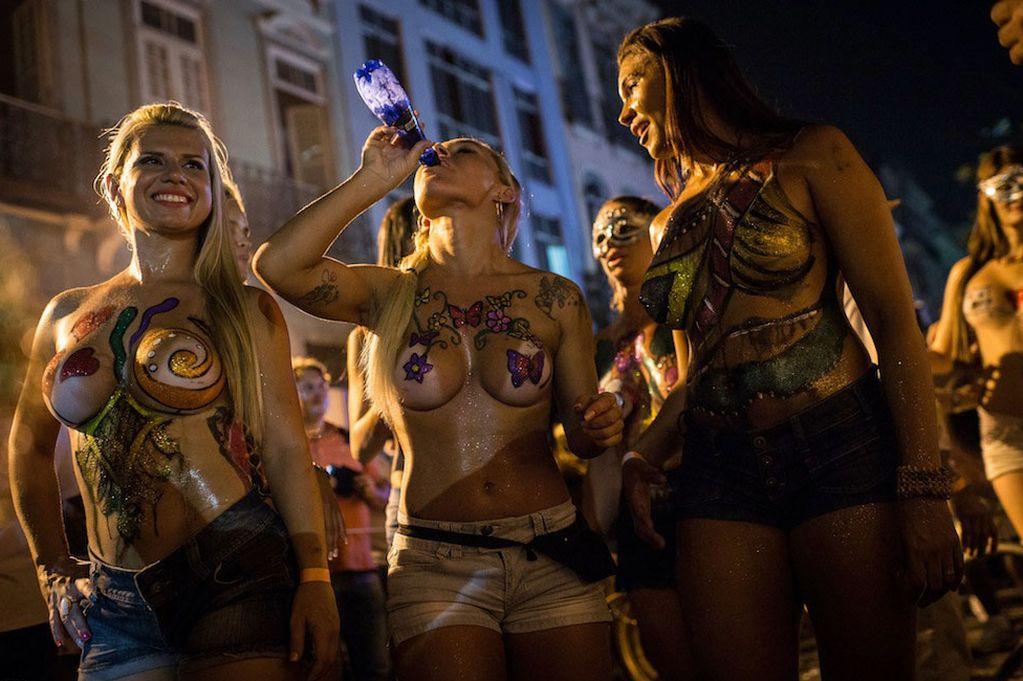 Topless-dancers-perform-during-a-street-parade-of-Banda-da-Rua-do-Mercado-MAIN