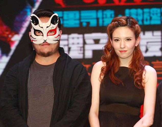 "Pic shows: Japanese porn star Rola Misaki with a man in a mask who is believed to be the magnate. A Japanese porn star has been given a 5million GBP contract to give a Chinese businessman 15 years of exclusive service. Double-D Rola Misaki, 22, who also appears using the name Rola Takizawa and who is half Russian, has been offered the exclusive deal as a personal assistant by the mystery businessman who is said to work in the entertainment industry. According to sources quoted in local media: ""His property holdings alone are worth several hundred million dollars. ""At events, his behaviour includes giving million-dollar tips to participants."" The pair are said to have recently attended an event together in the Chinese capital Beijing with him wearing a mask to hide his identity. The former actress appeared on stage holding hands with her superior. In spite of his use of a mask to conceal his identity, the display of affection caused many to presume that the contract also includes an ""intimate relations"" clause. Misaki made her debut in the adult video industry in 2012 with the Prestige Label. And although not finding many fans in Japan she has become a hit in China, where the government is reported to be more tolerant. According to Chinese journalist Eiji Miyagi: ""If you ask someone to name a popular Japanese person, the response would probably be the name of this AV actress. ""It is viewed as a way for the younger generation to let off steam."" She now has over 4.8 million followers on Sina Weibo, the Chinese equivalent of Twitter. Fans have now gone online to mourn the loss of the porn star. One, GuangY, wrote: ""Nooo! She can't leave us like this."" Another, Mai86, wrote: ""She's one of the best, a natural. I can't believe she's gone off with this man."" While Bao Hung posted: ""It's a sad day for us fans. Come back to us after 15 years. We'll still be here."" (ends)"