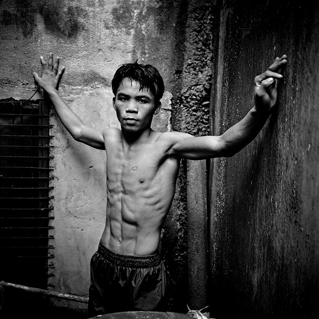 Manny Pacquiao, aged 17, train at LM Gym in Manila. Manny ran away from his impoverished home at the age of 14 in order to lessen the burden of his mother, who was raising six children alone in General Santos City in the southern Philippine island of Mindanao. He found work in Manila in warehouses and construction sites but drifted back to his great love, boxing. He turned pro in 1995 when he was 16 — and a light flyweight at just 106 lbs. In 2008 he bought the building, had it torn down and built a 7 story modern complex, with a boxing gym, recording studio, billiard room, and a dormitory